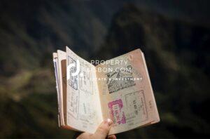 Someone holding a passport.