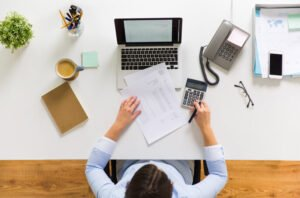 Top view of business women at desk.