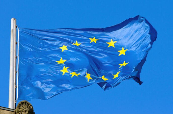 European Union flag on blue sky.